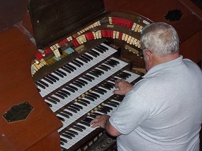 Click here to download a 2592 x 1944 JPG image showing Cyrus Roton at the console.