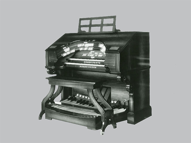 Click here to download a 1600 x 1280 JPG image SHOWING a double bolster scroll-top 2 manual WurliTzer console.