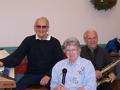 Click here to download a 2032 x 1534 JPG image showing Eugene, Nancy and Aldo of the Center Street Combo.