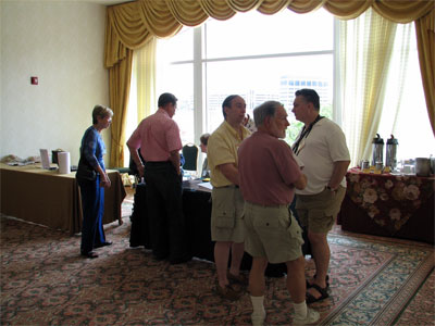 Click here to download a 2592 x 1944 JPG image showing folks registring for the Convention.