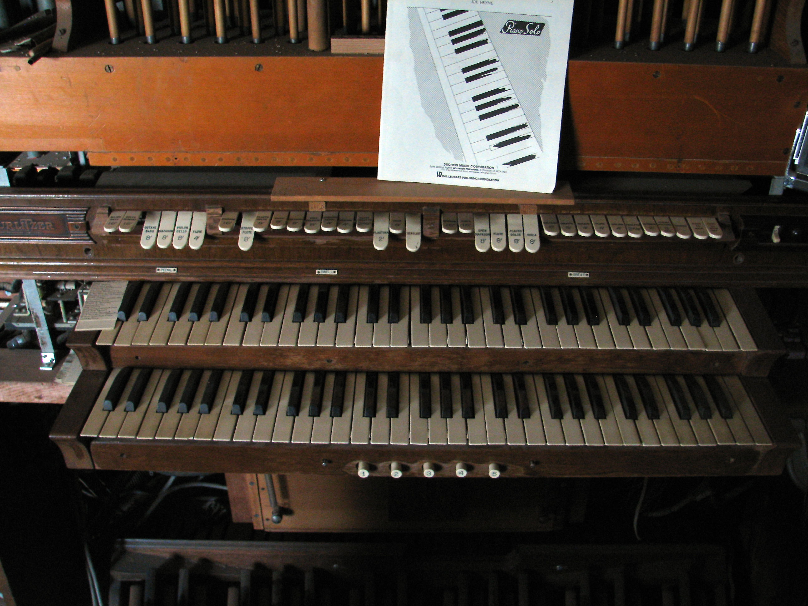 Click here to download a 2592 x 1944 JPG image showing the playing table of the 2/3 Mighty Spohn Pipe Organ installed in the organ shop upstairs.