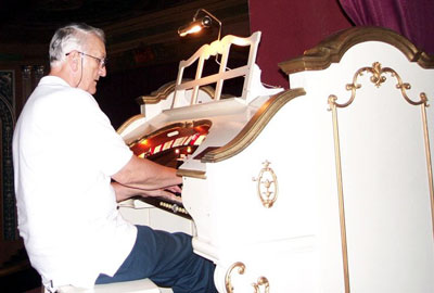 Click here to download a 700 x 472 JPG image showing Eugene Hayek at the console of the Lafayette Theatre's Mighty 2/11 WurliTzer Theatre Pipe Organ.
