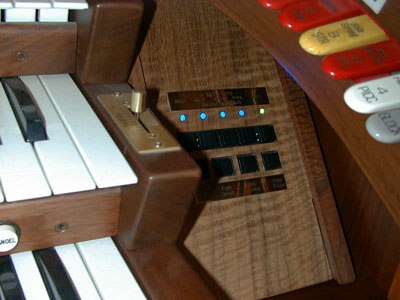 Download an 800 x 600 JPG image of a tight close-up of the MIDI controls on the right end block of the Rodgers Trio Electronic Analogue Theatre Organ.