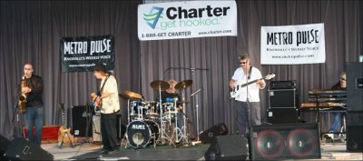 Click here to download a 772 x 324 JPG image showing MOJO playing suring the 2005 Smoky Mountain Blues Festical held at at Maryville Harley-Davidson in Maryville, Tennessee.
