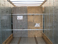 Click here to download a 2592 x 1944 JPG image shoving the cargo bulkhead installed in the 28-foot trailer at ABF in Tampa, ready for shipping to Knoxville, Tennessee.