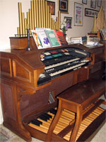 Click here to download a 1944 x 2592 JPG image shoving Tom Hoehn's Conn 653 Theatre Organ with electronic pipes.