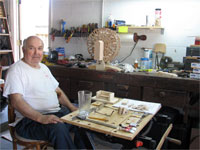 Click here to download a 2592 x 1944 JPG image shoving Papa Bill in his shop surrounded by his tools and work.