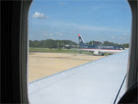 Click here to download a 2592 x 1944 JPG image shoving a view out the window of the aircraft as we roll out of the airport.