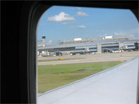 Click here to download a 2592 x 1944 JPG image shoving the ground falling away as we take off, leaving Florida soil.
