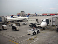 Click here to download a 2592 x 1944 JPG image shoving the gateway extended for passengers to board the aircraft at Hartsfield International Airport.