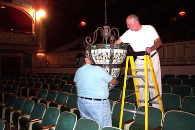 Click here to download a 2160 x 1440 JPG image showing Nelson Page and Bob Miloche changing lightbulbs in one of the chandeliers at the Lafayette Theatre.