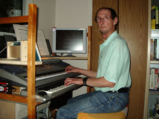 Click here to download an 800 x 600 JPG image of Russ Ashworth at the console of his Mighty MidiTzer.
