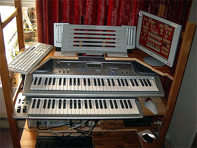 Download an 800 x 600 JPG image of Russ Ashworth's Mighty MidiTzer console, second version.