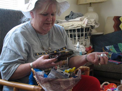 Click here to download a 2592 x 1944 JPG image showing Kimmy's mother, Vicky Wood, opening gifts after arriving at Walnut Hill for her ten day vacation with us.