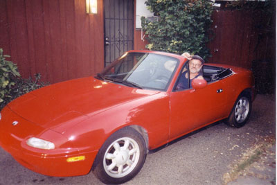 Click here to download a 1772 x 1184 JPG image showing Paul Kealy seated in his bright red Zoomer!