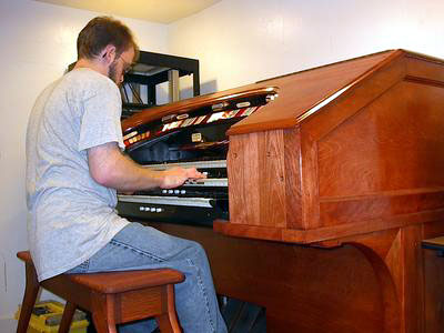 Click here to download a 1600 x 1200 JPG image showing Aaron at the console of his converted Kilgen Theatre Organ.