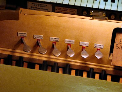 Click here to download a 2816 x 2112 JPG image showing the left side piano pedals.