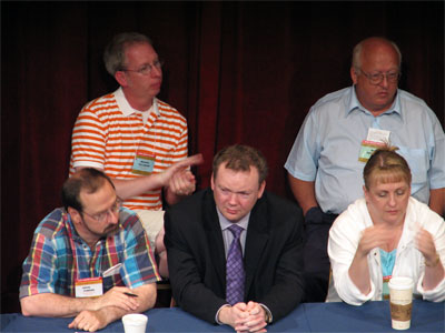 Click here to download a 2592 x 1944 JPG image showing Russell Holmes (center) with fellow board members Michael Fellenzer and Doug Powers (left) along with Bob Favidson and Donna Parker (right) at the Tampa Theatre during the 51st Annual ATOS Convention of 2006.