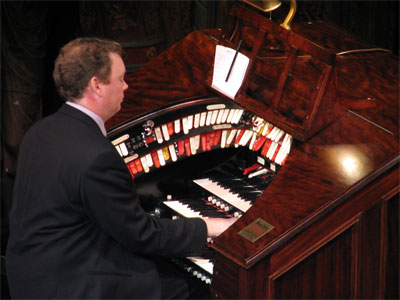 Click here to download a 2592 x 1944 JPG image showing Russell Holmes at the constole of the 3/14 Mighty WurliTzer.