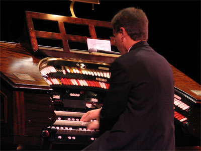 Click here to download a 2592 x 1944 JPG image showing Ron Rhode at the console of the 3/14 Mighty WurliTzser.
