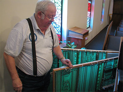 Click here to download a 2592 x 1944 JPG image showing Cyrus Roton standing at the rear of the console of the the Rodgers 755 Digital Church Organ with the two tone generator board frames swinging out.