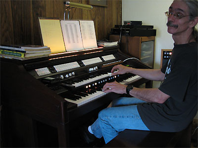 Click here to download a 2592 x 1944 JPG image showing the Bone Doctor at the console of the Mighty Rodgers/Artisan organ.