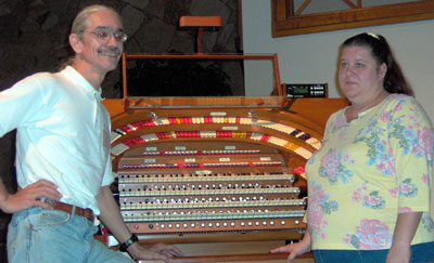 Click here to download a 2049x 1250 JPG image of Doc and Kimmy standing at the console of the J.Tyson Forker Memorial 4/32 Mighty WurliTzer Theatre Pipe Organ installed at Grace Baptist Church in Sarasota, Florida.
