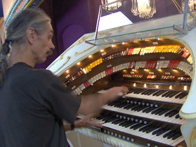 Click here to download a 2048 x 1536 JPG image of the Bone Doctor at the console of the Mighty 3/12 Page Theatre Pipe Organ
