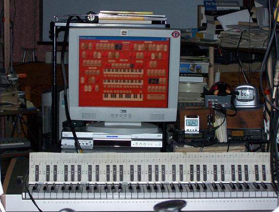 Download a 1917 x 1460 JPG image of Fred's MidiTzer, looking at the center flat panel LCD monitor.