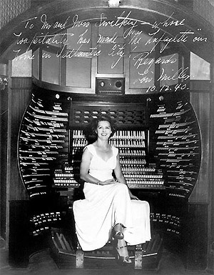 Click here to download a 390 x 500 JPG image showing Loise Miller at the console.