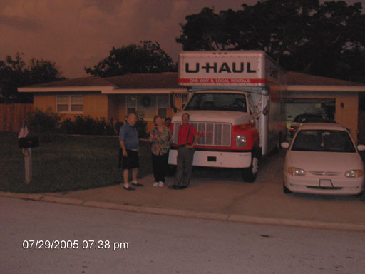 Click here to download a 2048 x 1536 JPG image of Papa Bill, Katie and Tom standing next to the 24-foot U-Haul truck just before the offloading began.
