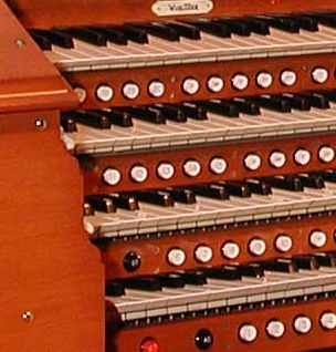 The Thumb Pistons, under the keys of a large Theatre Pipe Organ console. Click here to see the entire console.