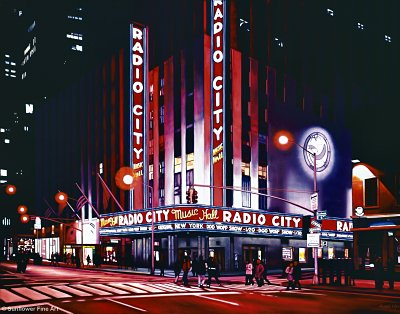 Click here to download a 2100 x 1650 JPG image showing the entrance to the Radio City Music Hall at night.