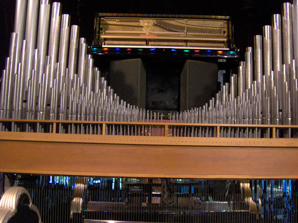 Click here to download a 2048 x 1536 JPG image looking up at the upright piano and the unenclosed classical rank above the stage.