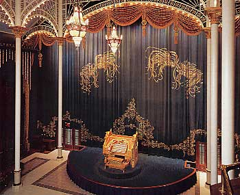 Here, you can see the organ console on the lift in the stage of the huge Salon.