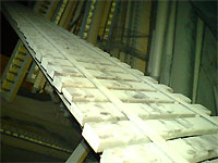 Click here to download a 640 x 480 JPG image showing a rack of metal harp bars.
