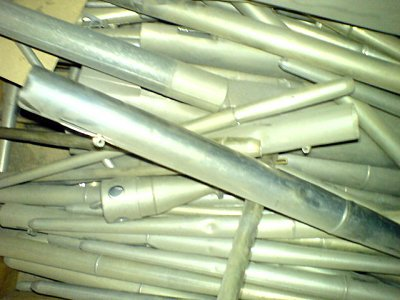 Click here to download a 640 x 480 JPG image showing a jumbled array of metal Reed pipes.