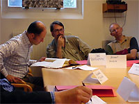 Click here to download a 640 x 480 JPG image showing the planning papers being brought out on the table.