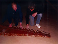 Click here to download a 1394 x 978 JPG image showing workers lining up Tibia pipes for inventory.