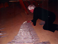 Click here to download a 1384 x 994 JPG image showing workers lining up String pipes for inventory.