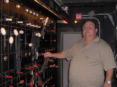 Click here to download a 2048 x 1536 JPG image of Bill Shrive standing next to the Tampa Theatre Lighting Control System.