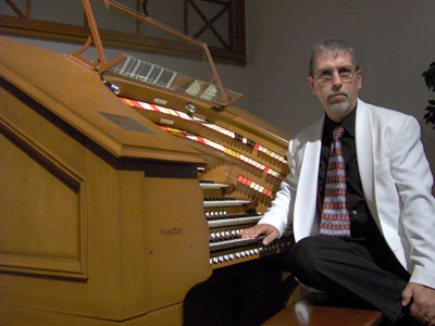 Click here to download a 2048 x 1536 JPG image showing Tom Hoehn at the console of the J. Tyson Forker Memorial WurliTzer Theatre Pipe Organ installed at Grace Baptist Church in Sarasota, Florida.