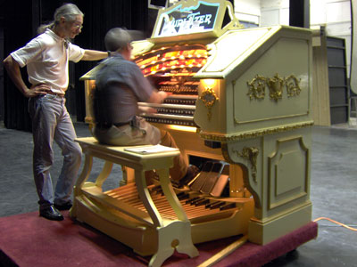 Click here to download a 2048x 1536 JPG image of the Bone Doctor standing at the console of the 3/18 Mighty WurliTzer Theatre Pipe Organ installed at Lake Brantley High School in Orlando, Florida as Tom gives her a go, too fast for the camera!