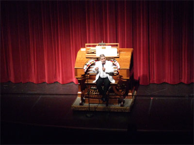 Click here to download a 2048 x 1536 JPG image showing Tom Hoehn at the console of the 3/16 Mighty WurliTzer Theatre Pipe Organ installed at Tom Worthington High School, Columbus, Ohio.