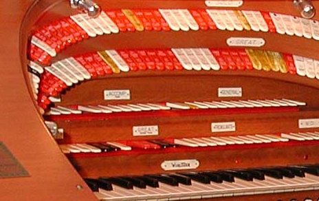 The muticolored Stop Tongues in the horseshoe of a large Theatre Pipe Organ console. Click here to see the entire console.