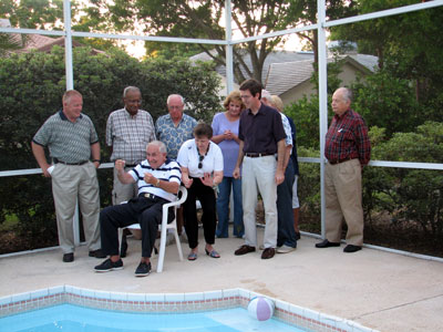 Click here to download a 2592 x 1944 JPG image showing members of the Choir playing Charades by the poolside at Ebbie's home.