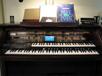 Click here to download a 2576 x 1932 JPG image showing the keydesk of Eleanor Winnemore's Roland Atelier Digital Residence Organ.